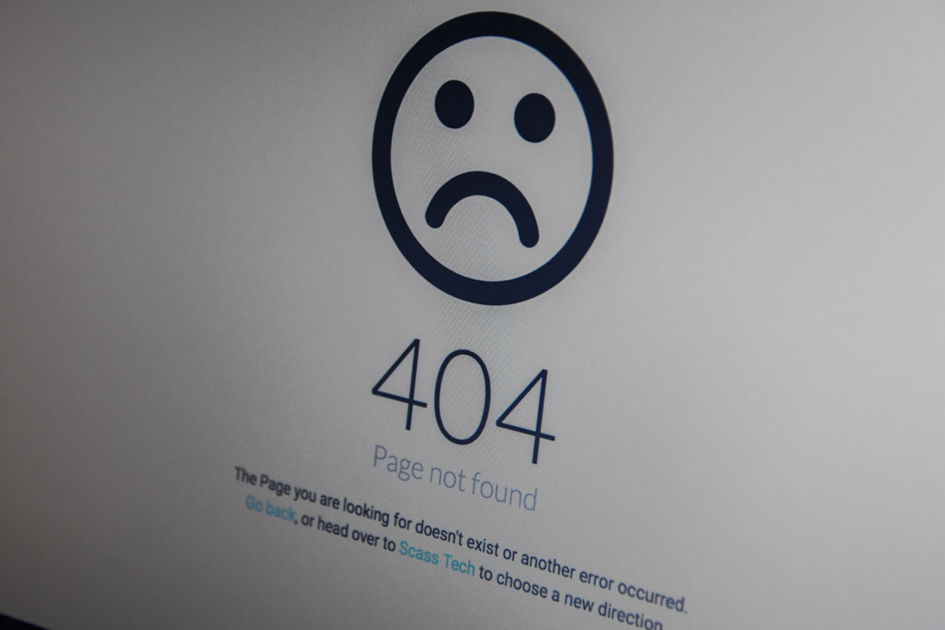 404 error message page on a laptop screen.