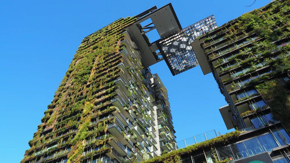 A large, dual-column apartment building in New York with the worlds largest vertical garden cladding the exterior
