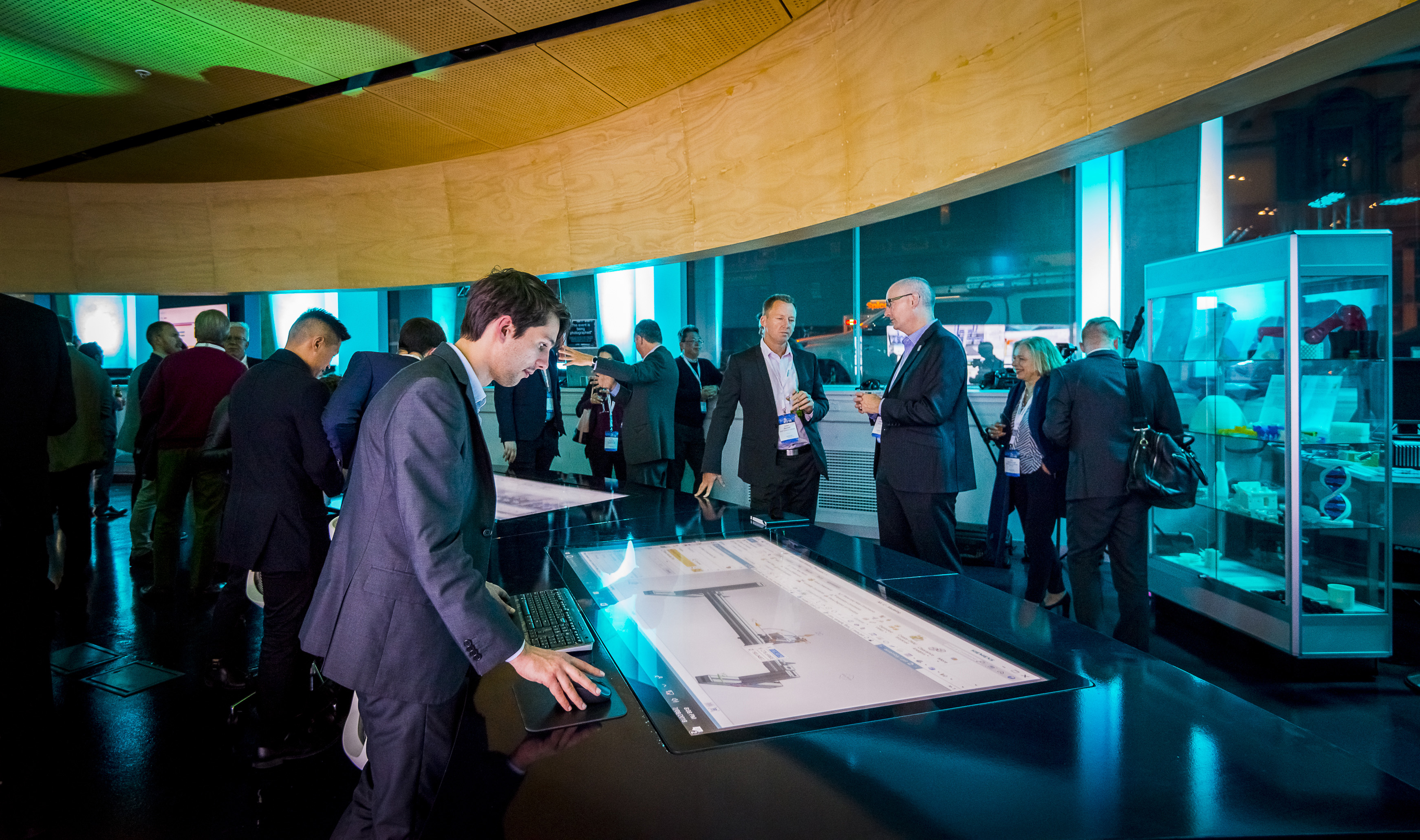 Swinburne graduate Callan Halton, operating a touch screen showing a Siemens factory simulation at the MindSphere launch event
