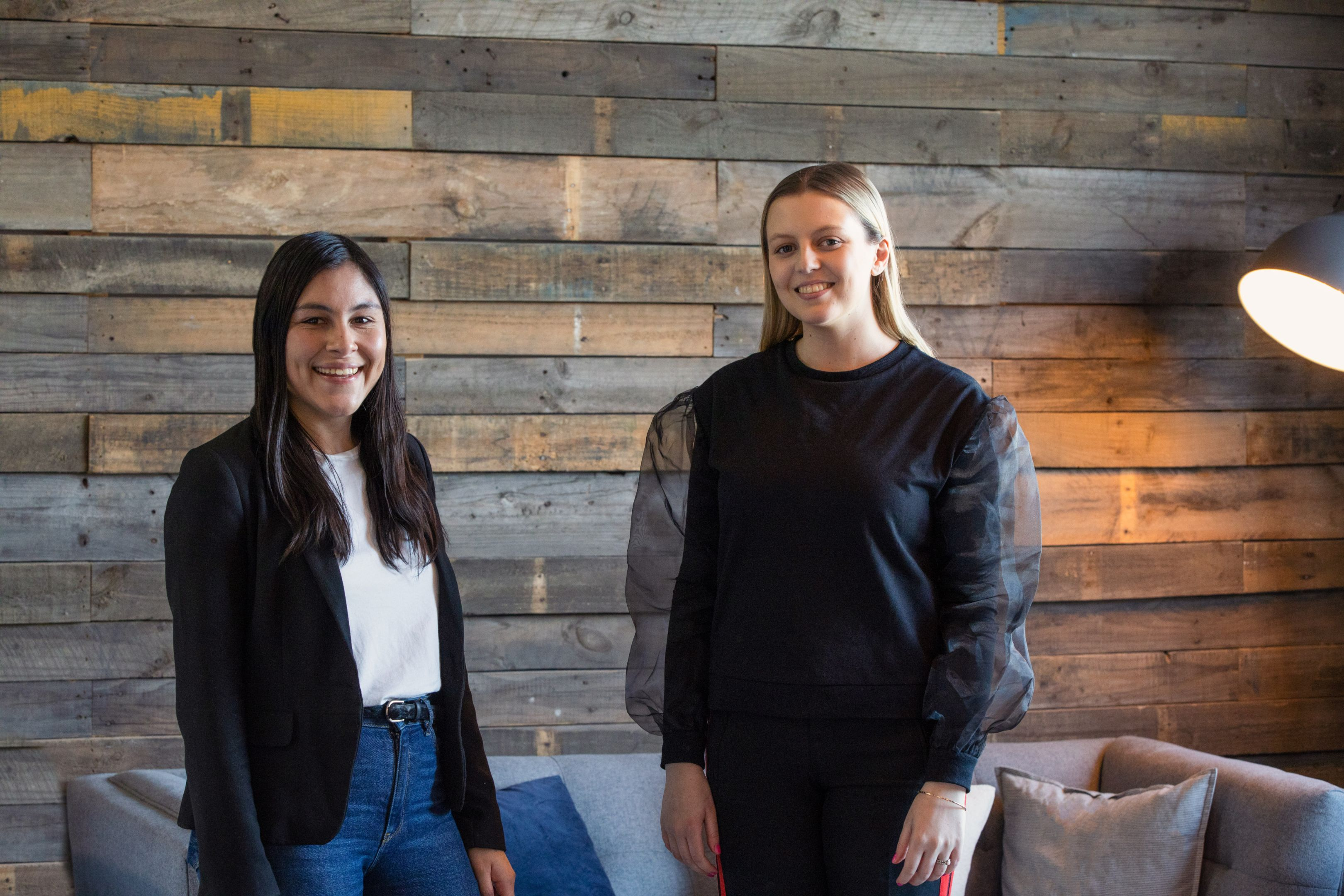 Photograph of Hotglue social media manager Beatrix Fisher and Swinburne professional placement student Sophie Evans.