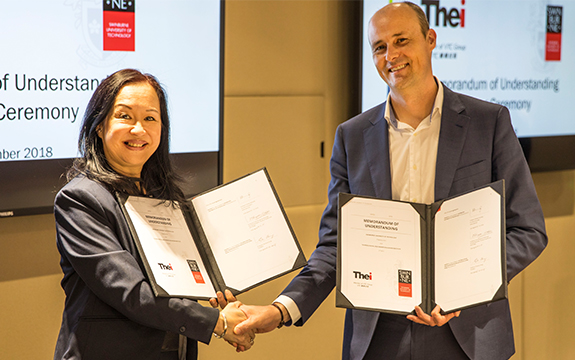 Professor Scott Thompson-Whiteside Pro-Vice Chancellor, Faculty of Health, Arts and Design and Professor Christina Hong President of THEi after signing the Memorandum of Understanding.