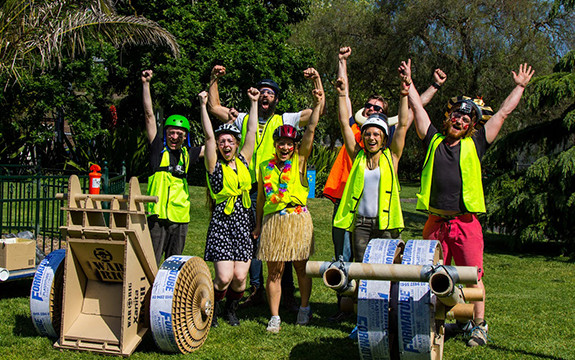 Swinburne Design factory students stand in Hawthorn's Central Gardens with their paper bikes