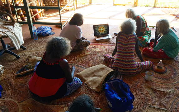 indigenous elders watch animation of their weaving practices