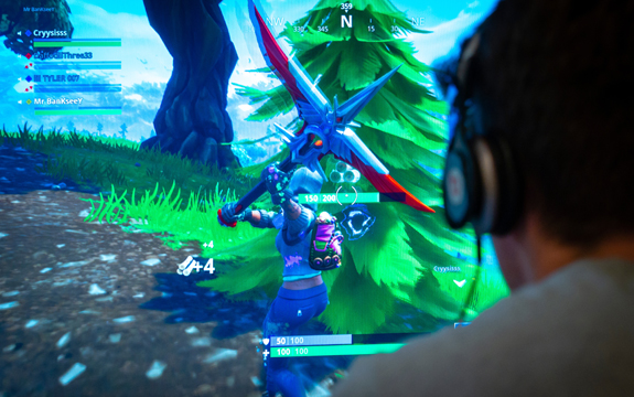 Call that a weapon? Playing Fortnite, a web-based multiplayer survival game. | Image: Shutterstock/Lenscap Photography