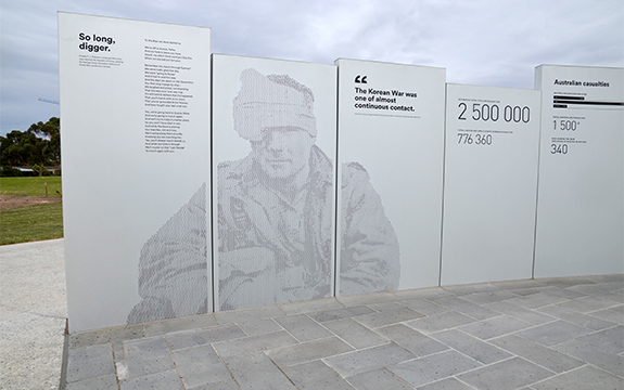 Australian soldier and graphics on perforated memorial panels