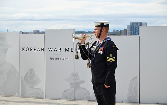 Soldier playing the last post at the memorial opening.