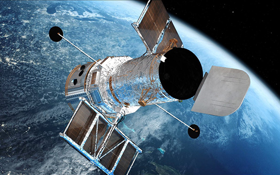 The Hubble Space Telescope in orbit above the Earth. Image credit: Swinburne Astronomy Productions.