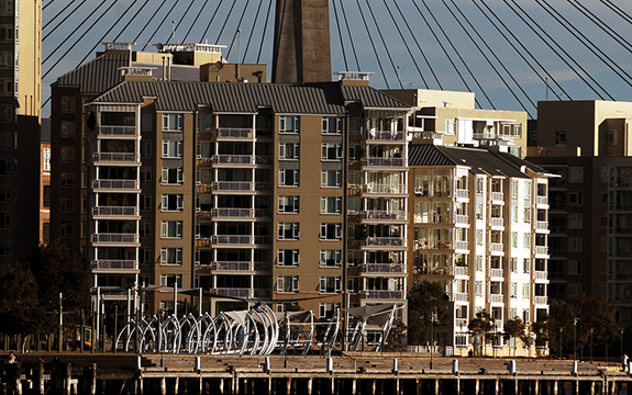 Sydney investors can profit equally from purchasing apartments or houses. Mick Tsikas/AAP