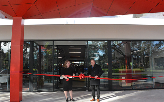 Swinburne's Mish Eastman and Peter Arandt cut the ceremonial ribbon to the new entrance.