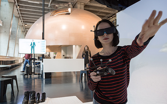 Girl using 3D glasses in the Factory of the Future