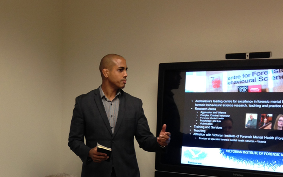 A front on shot of Stephane Shepherd presenting to a small group of people
