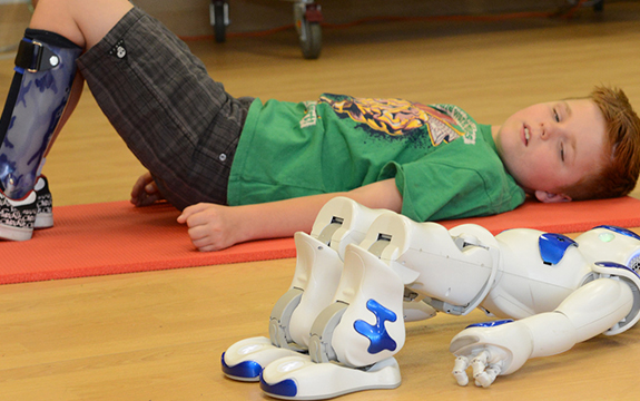 RCH patient, Miles, working with NAO. Alvin Aquino/RCH