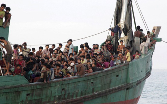 Rohingya and Bangleshi migrants wait on board a fishing boat before being transported to shore, off the coast of Julok, in Aceh province. Photo: Reuters