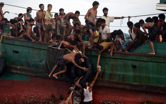 A boat crammed with scores of Rohingya migrants recently found drifting in Thai waters. Photo: CHRISTOPHE ARCHAMBAULT/afp