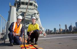 Preparing for the on-board trials on HMAS Canberra, Dr Andrew Ang and Mr Matthew Leigh. | POIS Yuri Ramsey, Navy Imagery Unit, Department of Defence.
