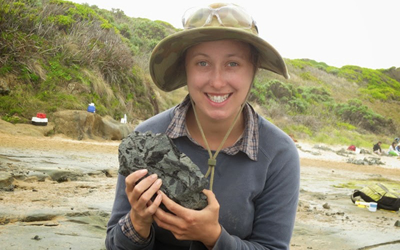 Jessica Parker with elaphrosaur fossil at Eric the Red dinosaur dig site near Cape Otway