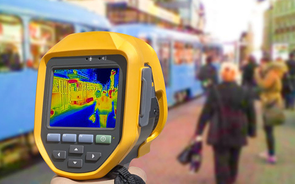 Thermal imaging camera scanning members of the public for COVID-19