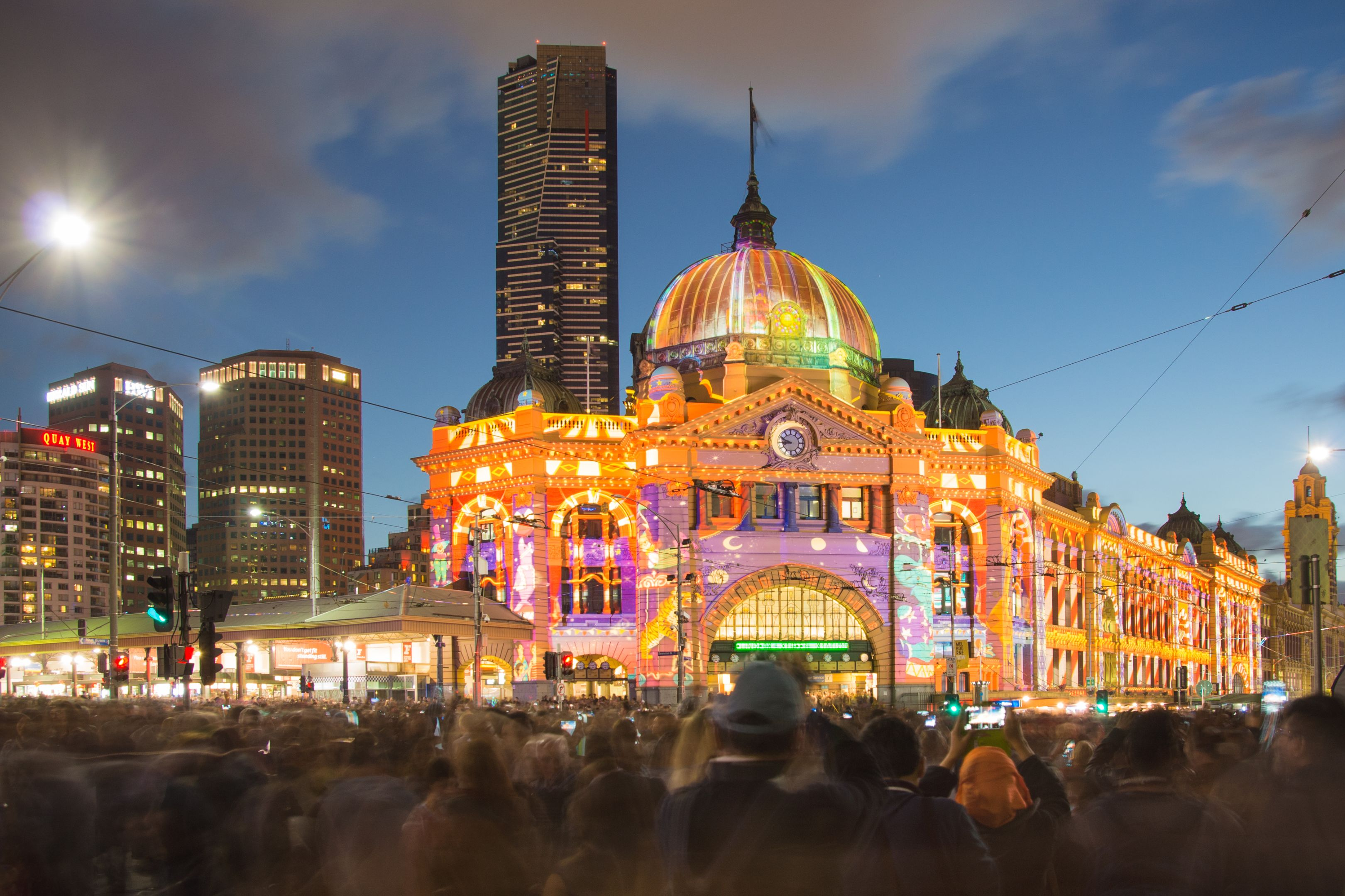 Flinders Street Station in Melbourne during the White Night Festival with large-scale artistic light projection.