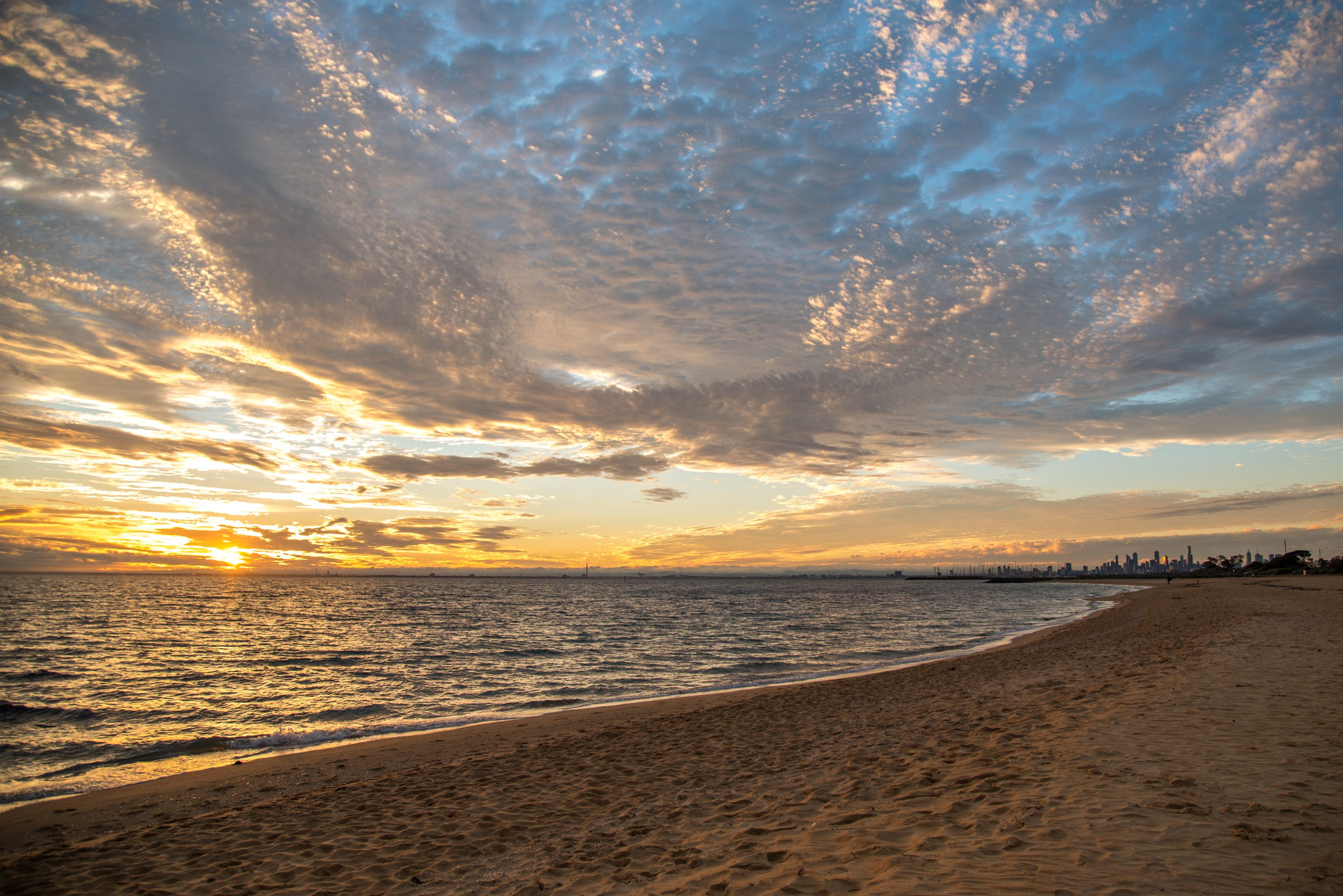 Sunset at Brighton Beach, Melbourne with the city in the background