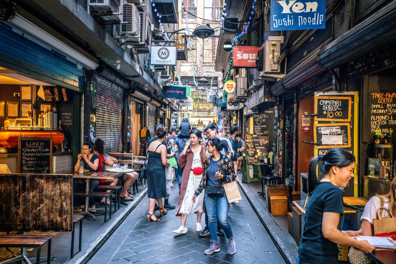 Street view of Centre Place an iconic pedestrian laneway with cafe and people in Melbourne Australia