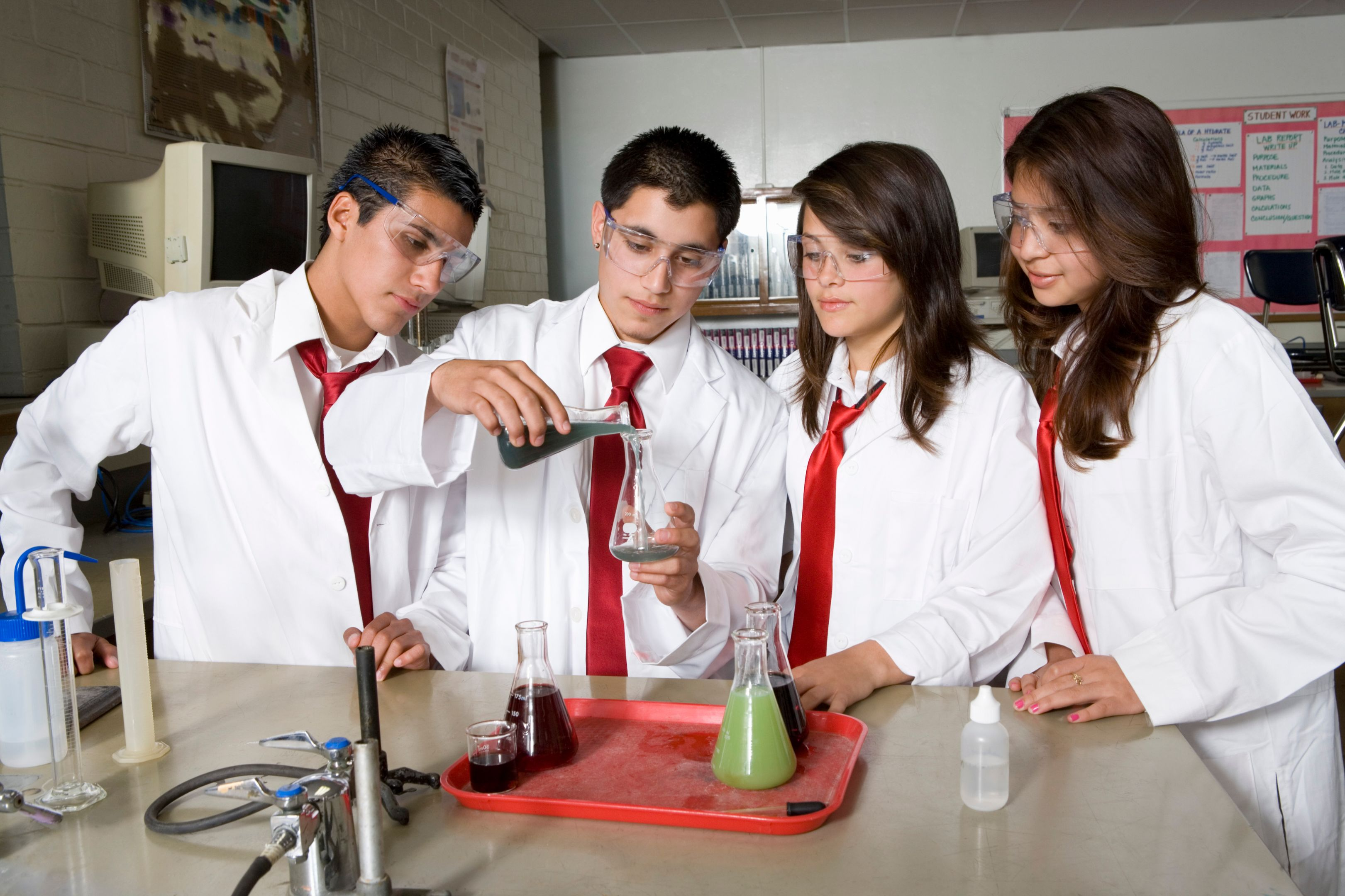 High school students conducting a science experiment.