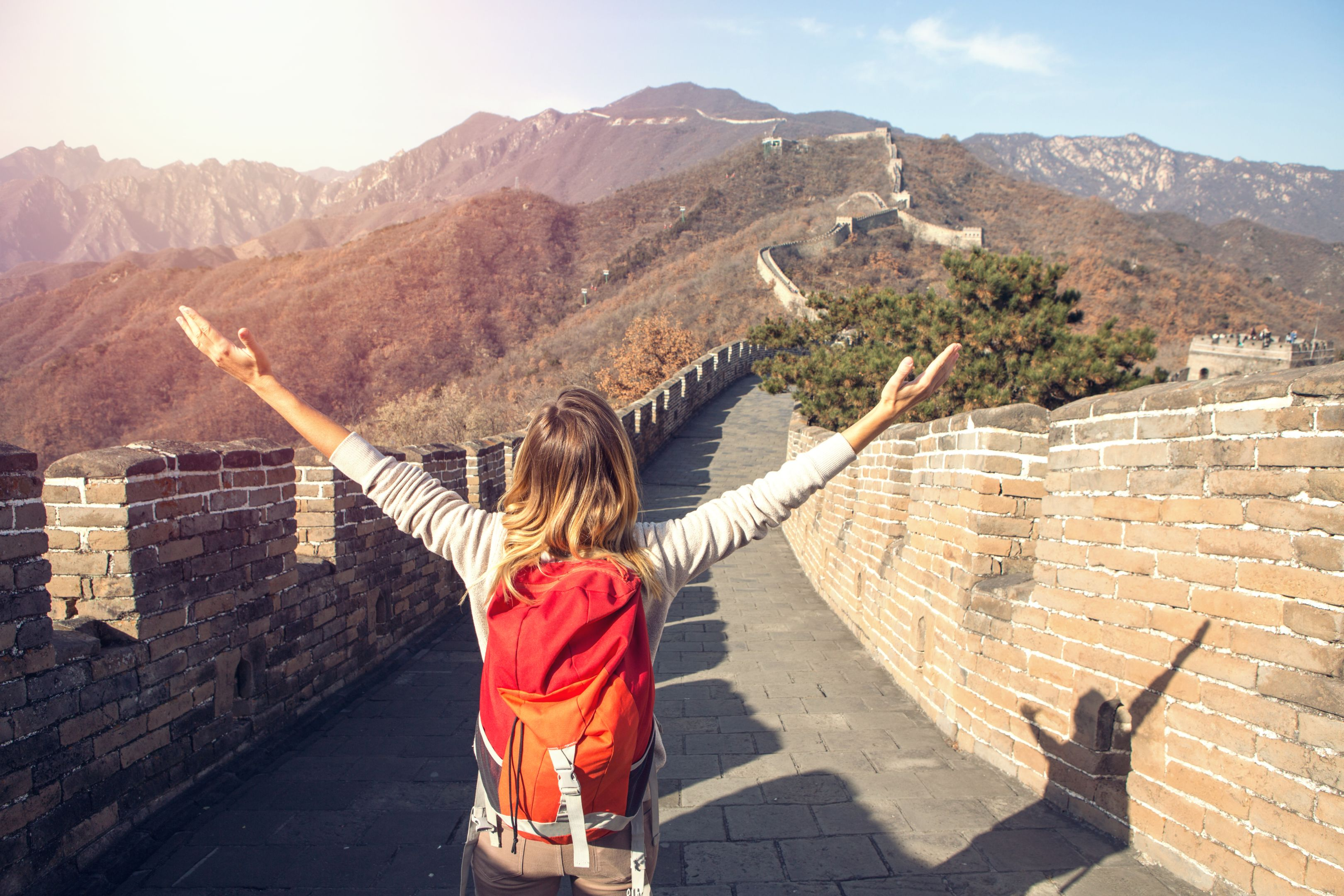 Young woman embracing nature-Great Wall of China