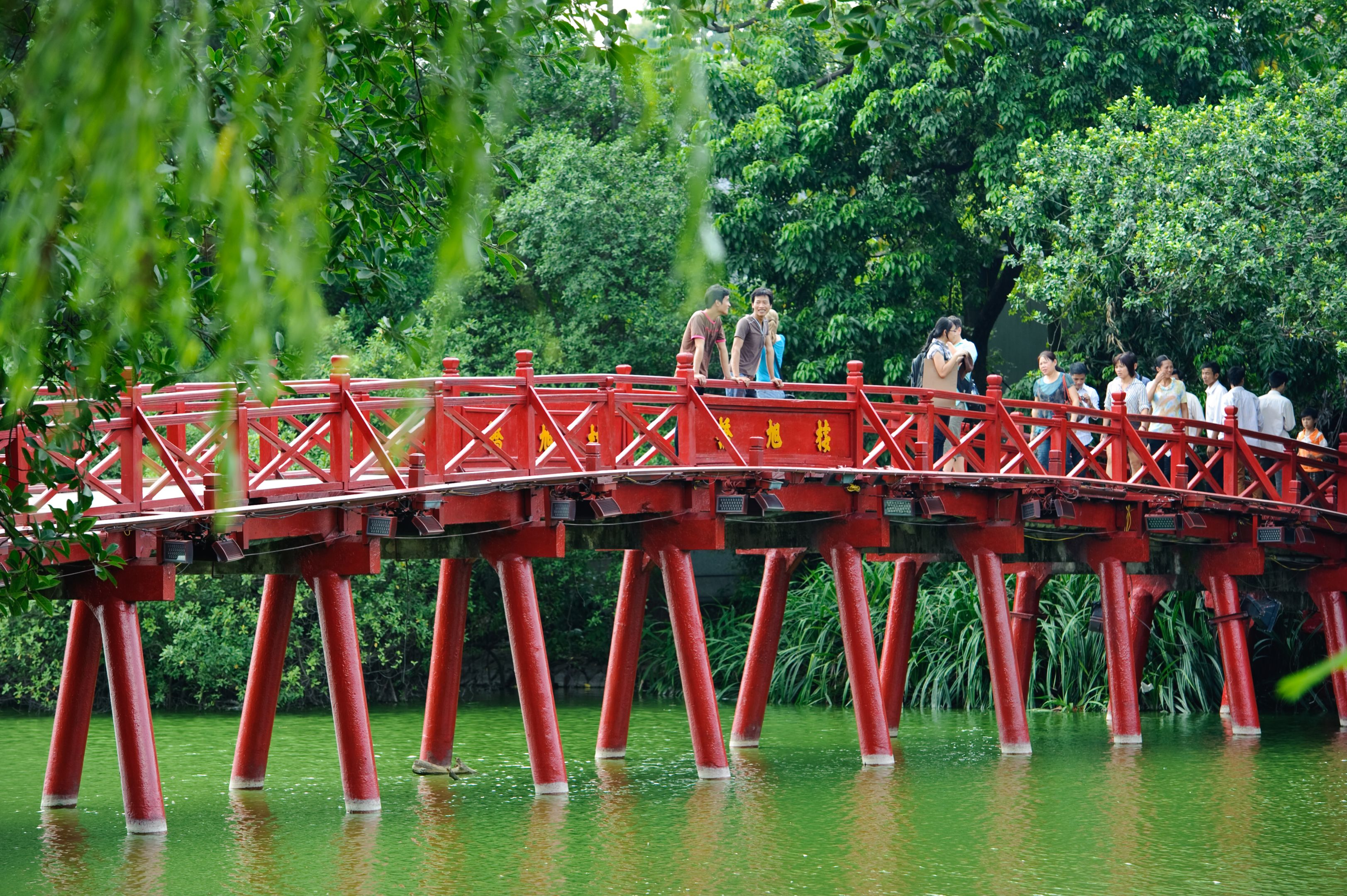 Hanoi red bridge. The wooden red painted bridge over the Hoan Kiem Lake connects the shore and the Jade Island on which Ngoc Son Temple stands
