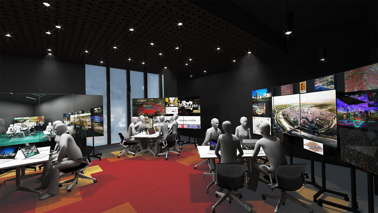 A computer-generated image showing a large office space with groups of 4 people seated around square tables working on laptops together, with large screens beside their table projecting various images.