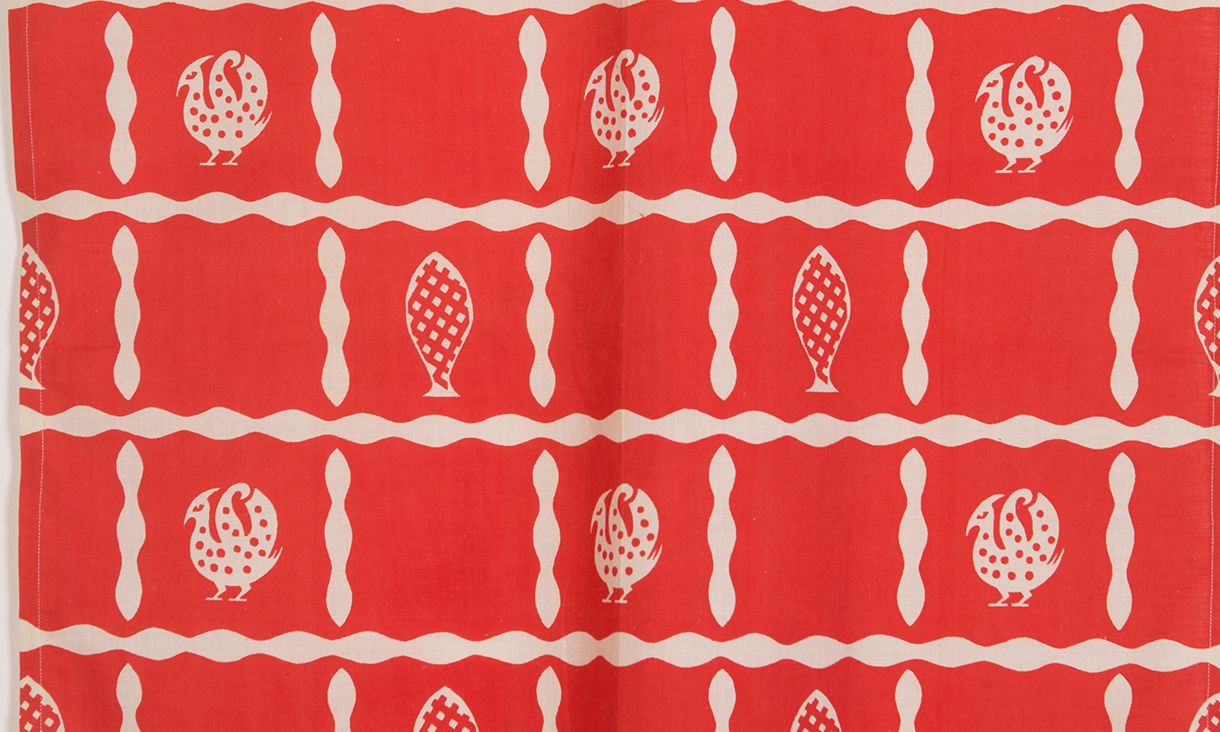 A frances Burke textile, red and cream with bird and tree print