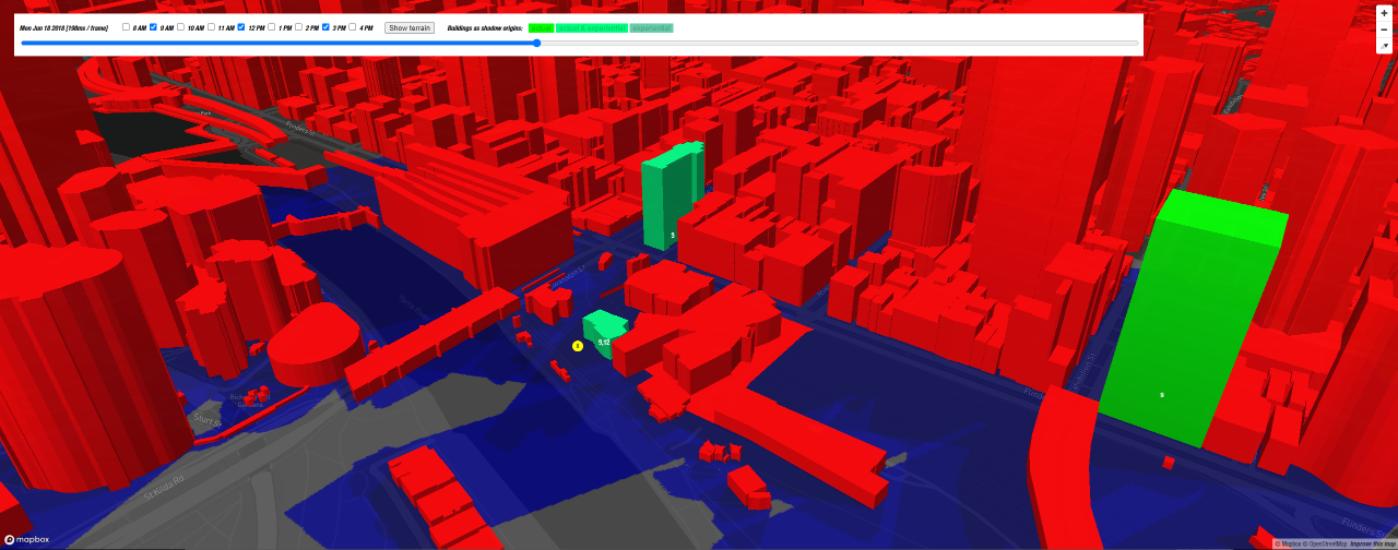 A computer-generated image showing a bird's eye view of a city with the buildings in red and green, on top of blue ground.
