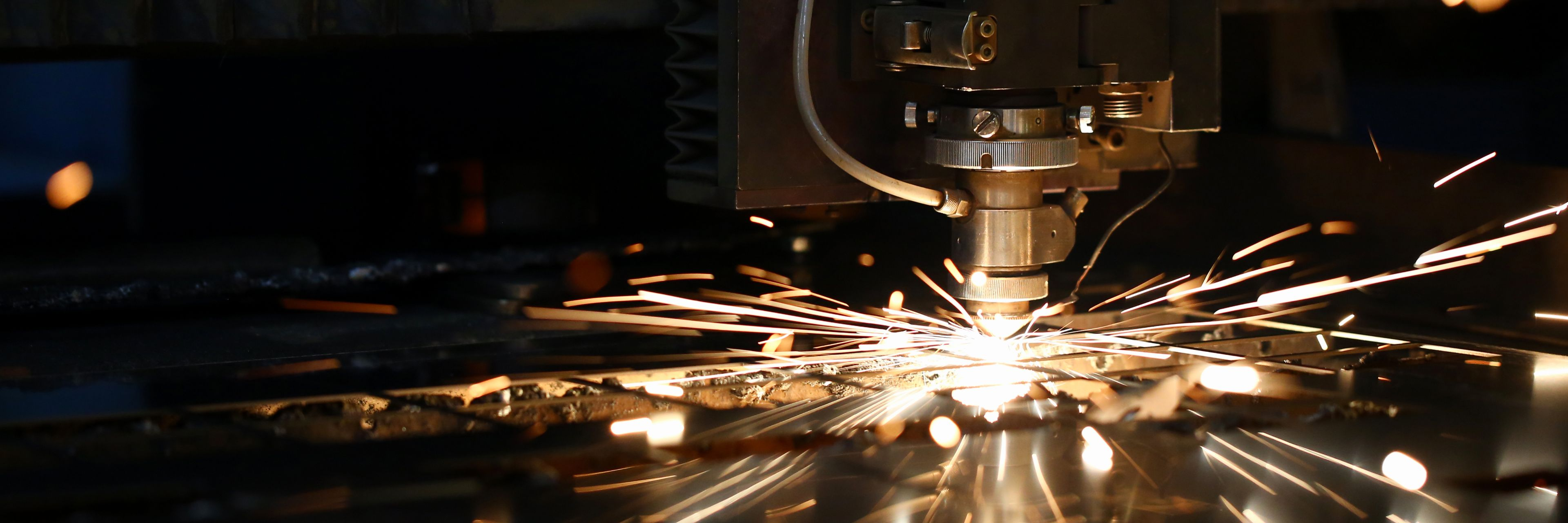 Sparks flying out a machine head for metal processing