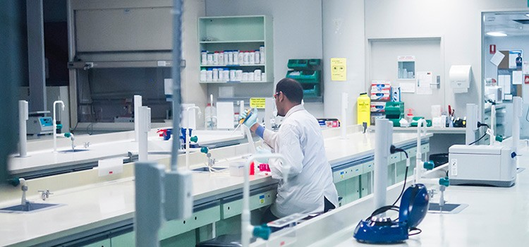 A member of our research team working in our laboratory.
