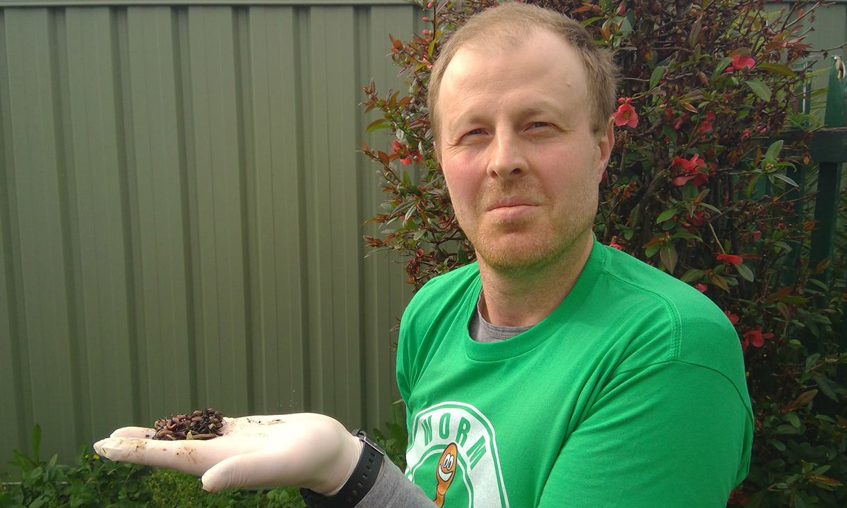 Ivan Maksimov wearing a green tshirt holding a handful of earthworms