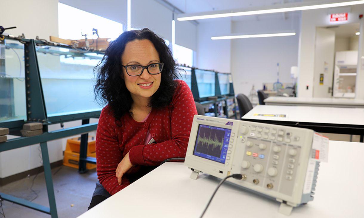 Elissa Goodrich seated in Swinburne wave lab