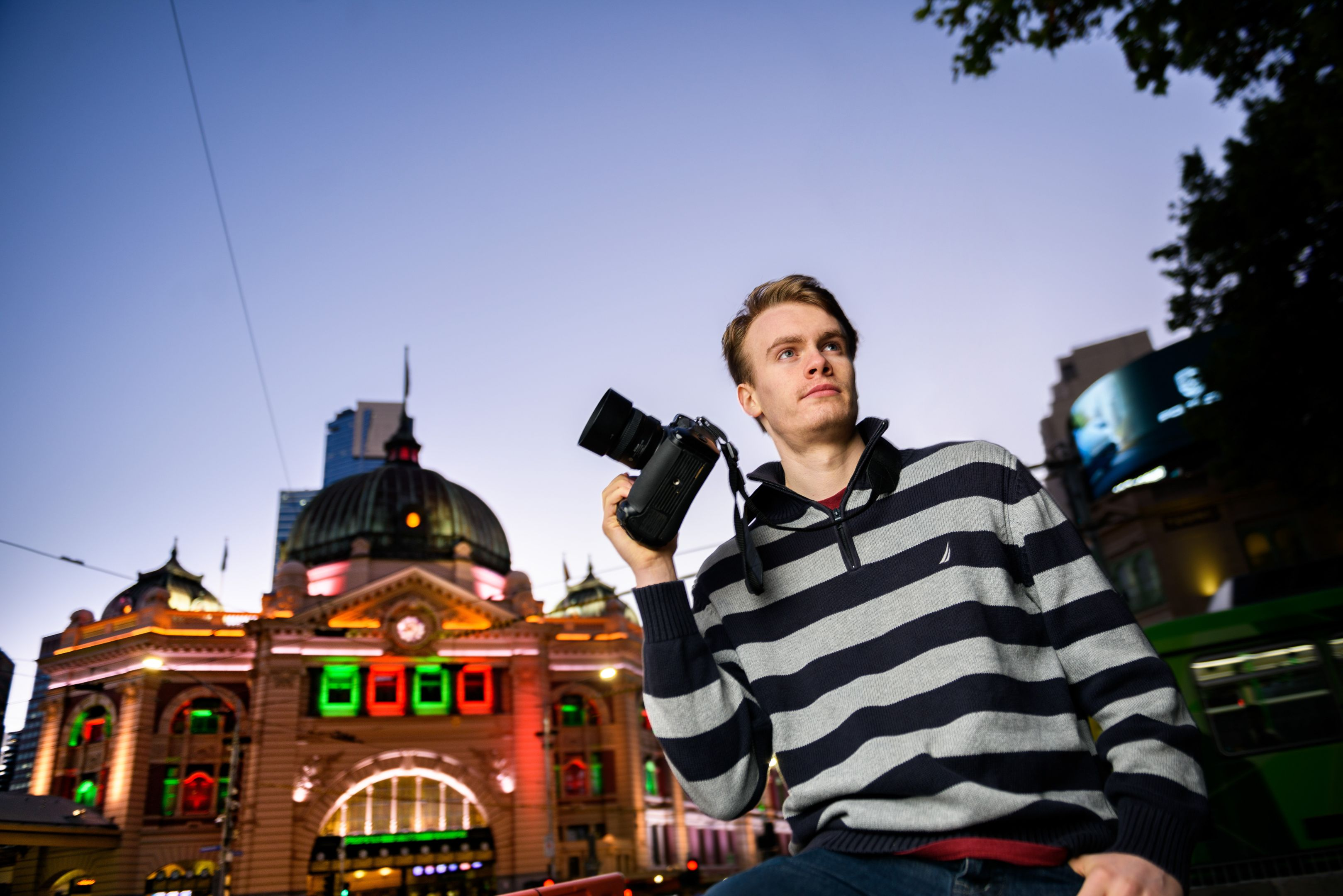 Jack Meehan Journalism Student at Flinders St Station with a camera in hand