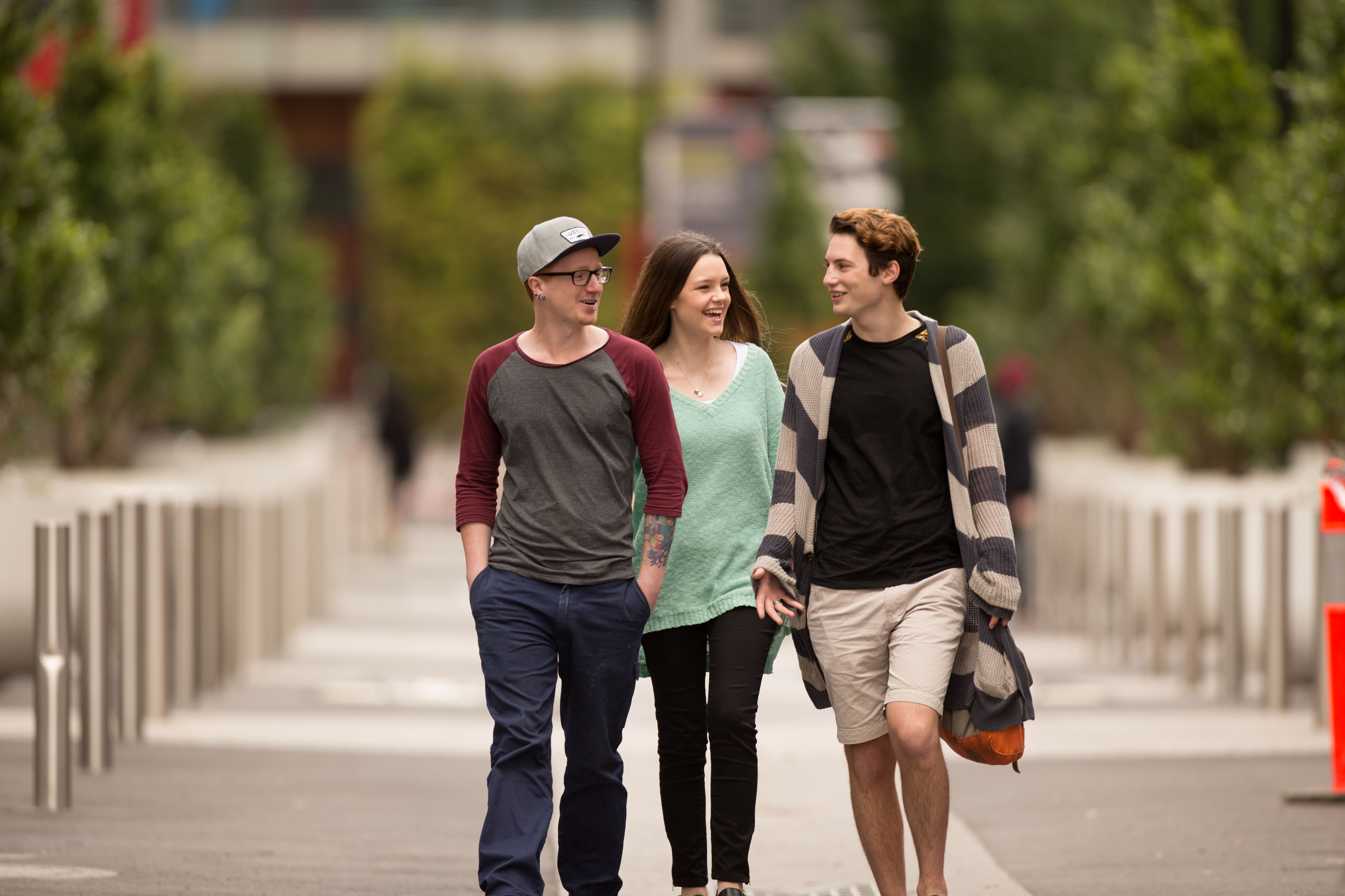 Three undergraduate students walking to class at Hawthorn campus