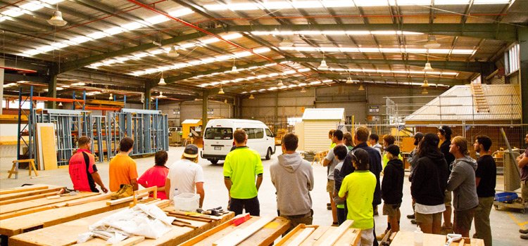 Image of the Swinburne University Croydon campus, showing students in the warehouse observing tutor.