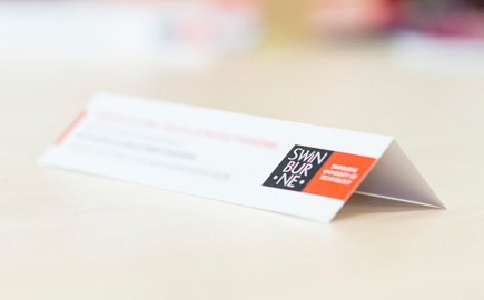 This is an image of a Swinburne University place-card, with the text blurred