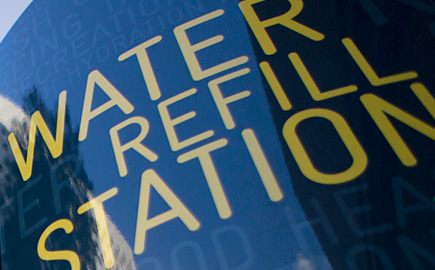 Close up image of the water refill station sign on campus