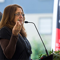 Aunty Joy Murphy, a Senior Wurundjeri Elder, delivering the Welcome to Country at Swinburne's Reconciliation Action Plan launch. Aunty Joy holds a gum leaf in her hand.