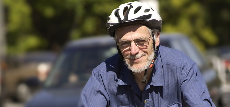 Frank Fisher on a bicycle