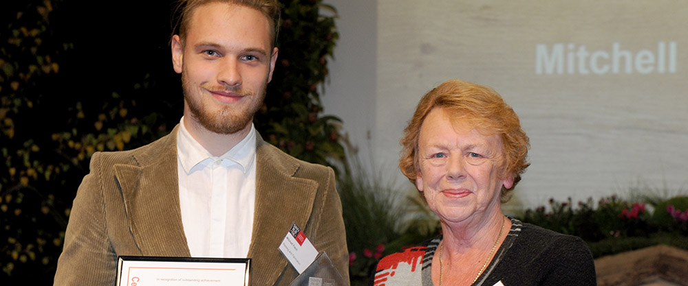 Annette Haworth, Rotary Club of Boronia, presenting Mitchell Fisch with the Swinburne Apprentice of the Year Award for 2016 after completing a Certificate III in Engineering – Fabrication Trade.