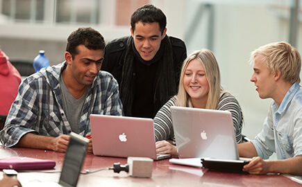 Group of students using laptops