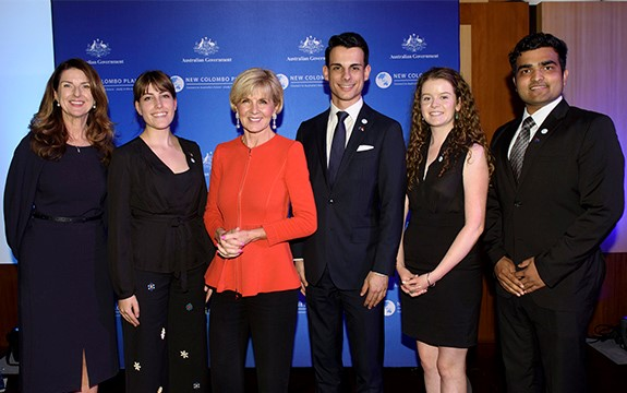 A group of 6 people stand together in-front of a banner with the New Colombo Plan and Australian Government logos.