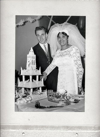 Grey scale wedding image from the Ngarrindjeri photo exhibition. The bride and groom are cutting a wedding cake.