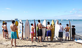 Swinburne international students learning to surf and an orientation day trip.