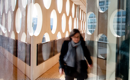 A woman walking through Swinburne's Advanced Technologies Centre