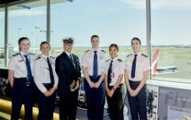 Swinburne's Abbey Boston right of QantasLink pilot Captain Adrian Young and other aviation students