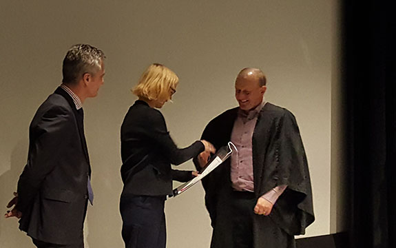 Andrew C Smith presents an award at the DET Inpsiring Managers program ceremony
