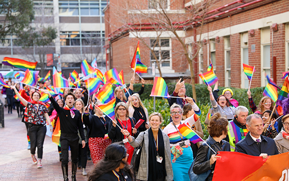 Swinburne staff and students walk proudly around the Hawthorn Campus with LGBTIQ flags